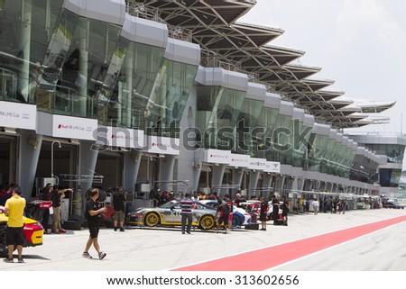 Sepang, Malaysia - September 5, 2015 : Teams pit for tires at Porsche Carrera Cup Asia AFOS, Sepang, Malaysia  - stock photo