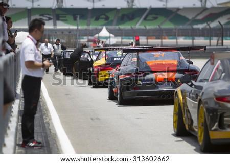Sepang, Malaysia - September 5, 2015 : Teams prepare to exit pit lane at Porsche Carrera Cup Asia AFOS, Sepang, Malaysia  - stock photo