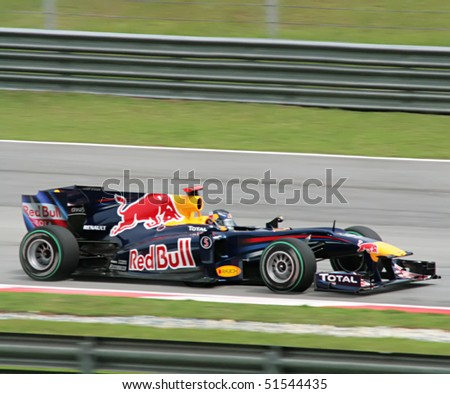 SEPANG, MY - APRIL 4: Sebastian Vettel of Red Bull Racing Team speeding during the F1 Petronas Malaysian Grand Prix 2010 on April 4, 2010 in Sepang, Malaysia. - stock photo