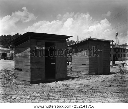 Separate But Equal privies for the construction workers at Clinton Engineer Works, 1943. Construction workers were building the X-10 facility in Oak Ridge, TN. - stock photo