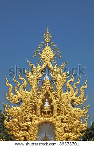 Separate chapel with statues of the Buddha. The chapel is ornated and overgilded in style of new Thai architecture