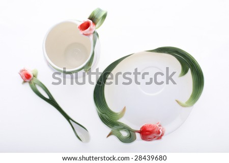 Separate isolated cup, sauser and spoon - stock photo