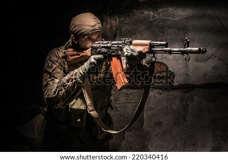 Separatist aiming with russian assault rifle - stock photo