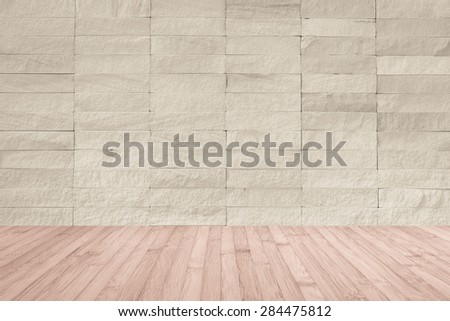 Sepia brown rock tile wall with wooden floor in light red brown color tone for interior background   - stock photo