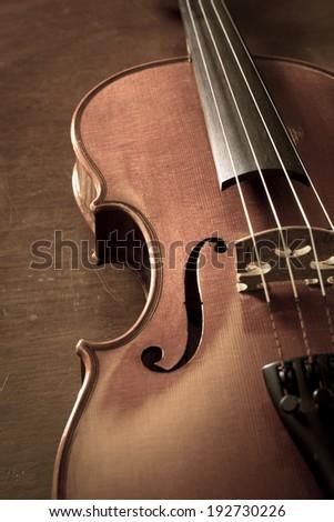 Sepia color of wood violin. - stock photo