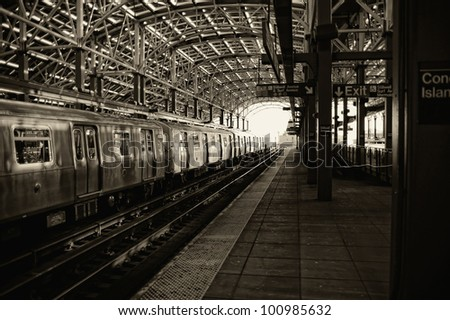 Sepia image of train and platform at the Coney Island subway station