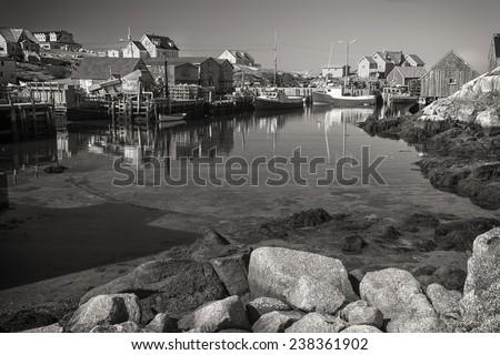 Sepia Peggy's Cove, a small village on Nova Scotia's coast. - stock photo