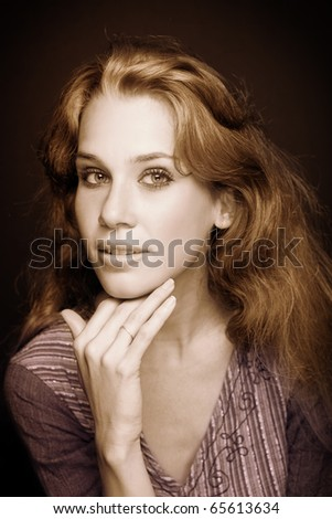Sepia portrait of beautiful young elegant woman - stock photo