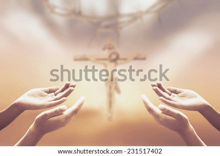 Sepia tone, hands of man praying over blurred crown of thorns and  Jesus with the cross on a sunset. Christmas, Worship, Forgiveness, Mercy, Humble, Repentance, Reconcile, Adoration, Glorify concept. - stock photo