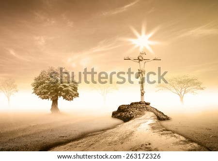 Sepia tone. Jesus on the cross over sunset background. - stock photo