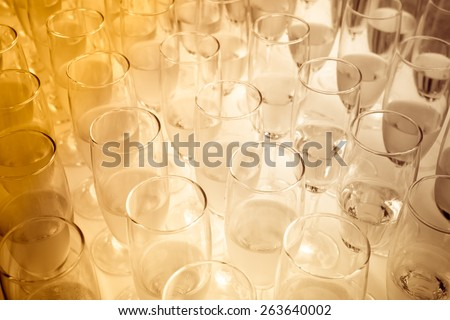 Sepia tone of party glasses filled with champagne. - stock photo