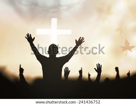 Sepia tone, silhouette people raising hands over blurred crown of thorns and the cross on nature background. - stock photo