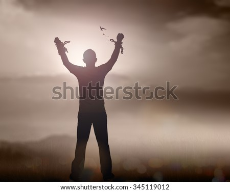 Sepia tone. Slave with broken shackles. Human hand in chain with bird on blur sunset background. International Day for Abolition Slavery Helper Redemption Liberate Unlock World Press Freedom concept. - stock photo