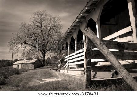 sepia tone 18th century farm landscape - stock photo
