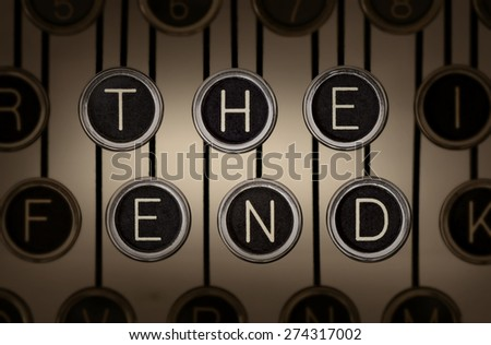 "Sepia-toned close up of old manual typewriter keyboard with scratched chrome keys that spell out ""THE END"" on two rows. Lighting and focus are centered on ""THE END"" keys.   - stock photo"