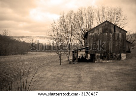 sepia toned landscape with 18th century farm