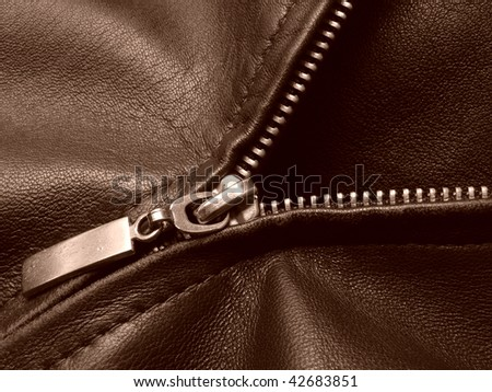 sepia toned leather jacket fragment with metal zipper - stock photo