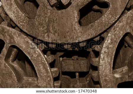 Sepia Toned Old rusty gears enmeshed on an antique sugar mill