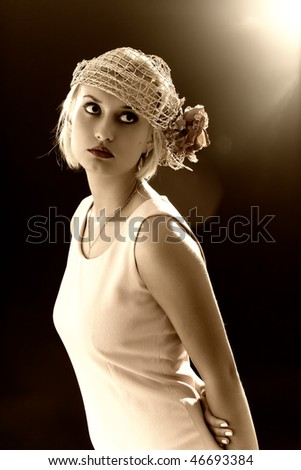 Sepia toned portrait of beautiful retro-style woman in bonnet. Professional make-up, lens flares - stock photo