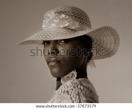 Sepia toned portrait of young african american female model wearing a hat - stock photo