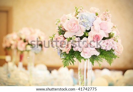Sepia toned reception hall decorated with flowers