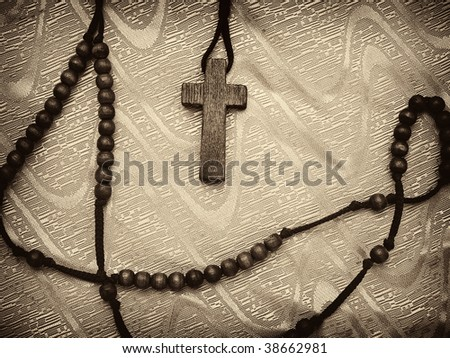 sepia toned rosary with vignette,high contrast image, useful for various religious themes - stock photo