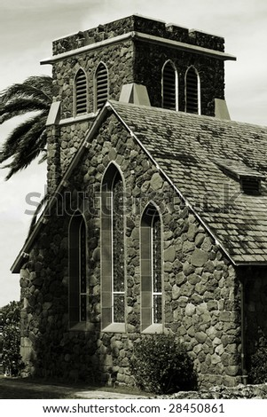 Sepia-toned stone Christian church with gothic arch windows - stock photo