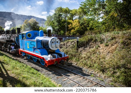 SEPTEMBER 28, 2014- GOLDEN, CO:Thomas the Tank Engine chugging into the Colorado Railroad Museum for the annual Day Out With Thomas event. - stock photo