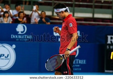 SEPTEMBER 26, 2014 - KUALA LUMPUR, MALAYSIA: Kei Nishikori of Japan reacts after his shot in his match at the Malaysian Open Tennis 2014. This event is an ATP sanctioned tournament. - stock photo