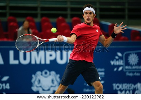 SEPTEMBER 25, 2014 - KUALA LUMPUR, MALAYSIA: Leonardo Mayer of Argentina makes a forehand return in his match at the Malaysian Open Tennis 2014. This is an ATP sanctioned tournament. - stock photo