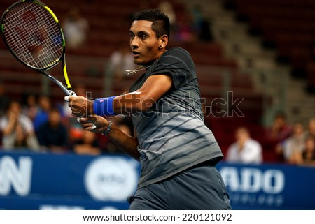 SEPTEMBER 23, 2014 - KUALA LUMPUR, MALAYSIA: Nick Kyrgios of Australia reacts after making a return in his first round match at the Malaysian Open Tennis 2014. This is an ATP sanctioned tournament. - stock photo