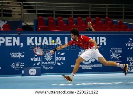 SEPTEMBER 23, 2014 - KUALA LUMPUR, MALAYSIA: Philipp Oswald from Austria chases to return a shot in his first round match at the Malaysian Open Tennis 2014 event. This is an ATP sanctioned tournament. - stock photo