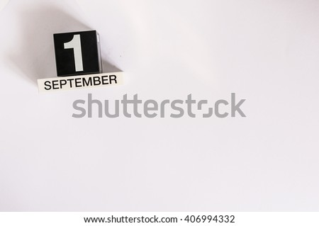 September 1st. Image of september 1 wooden black calendar on white background. Autumn day. Empty space for text. Back to school time - stock photo