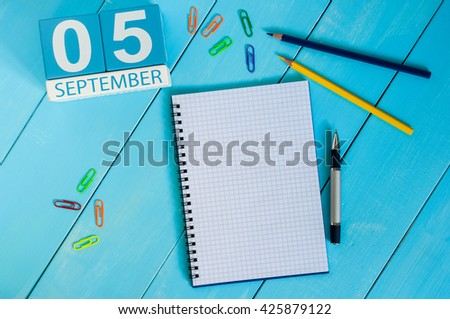 September 5th. Image of september 5 wooden color calendar on white background workplace. Autumn day - stock photo