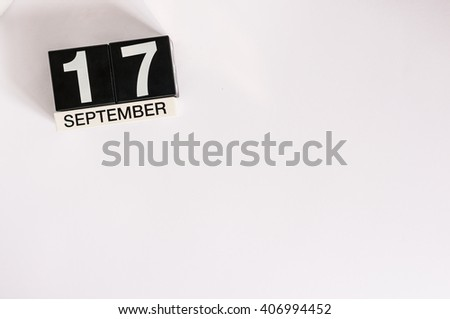September 17th. Image of september 17 wooden office calendar on white background. Autumn day. Empty space for text - stock photo
