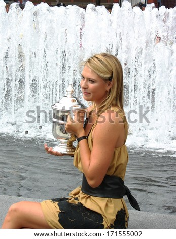 SEPTEMBER 10: US Open 2006 champion Maria Sharapova holds US Open trophy after her win the ladies singles final on September 10, 2006 in Flushing, New York  - stock photo