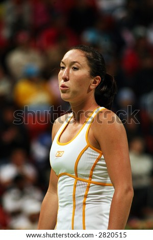 Serb tennis star Jelena Jankovic in action against Justin Henin in the Qatar Total Open, in Doha, March 2, 2007. - stock photo