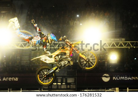 SERBIA, BELGRADE - APRIL 6, 2013: Motorbike rider performing the trick at Masters of dirt show at Kombank arena, most thrilling and spectacular freestyle motocross show - stock photo