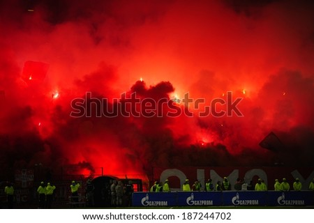 SERBIA, BELGRADE - APRIL 12, 2014: Soccer or football fans celebrating goal using pyrotechnics during Serbian championship soccer game between Red Star Belgrade and Cukaricki - stock photo