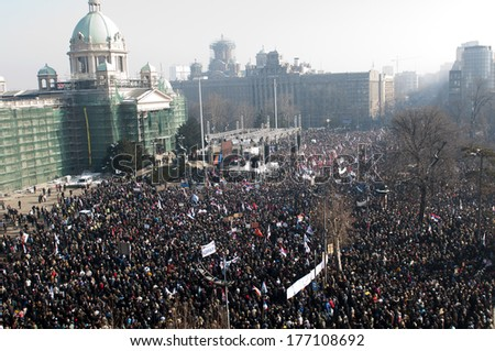 SERBIA, BELGRADE - FEBRUARY 5, 2011: Aerial view of crowd during a rally organized by Serbian Progressive Party in front of the Parliament building - stock photo