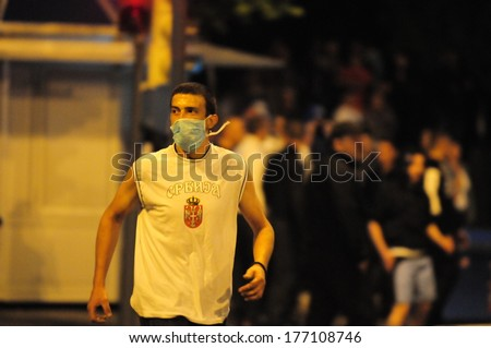 SERBIA, BELGRADE - MAY 29, 2013: Portrait of young protester wearing face mask during violent demonstrations - stock photo