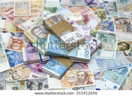 Serbian Dinar and another Currency on the Desk - stock photo