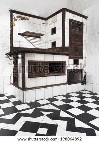 Serbian Old wood-burning stove in a kitchen , produced in 19th century - stock photo