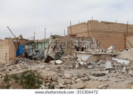 SEREKANIYE, SYRIA-MARCH 22: View of war damage from Serekaniye (Ras Al Ayn). Syrian war plane bombed Serekaniye. The Photo Taken, March 22, 2013. - stock photo