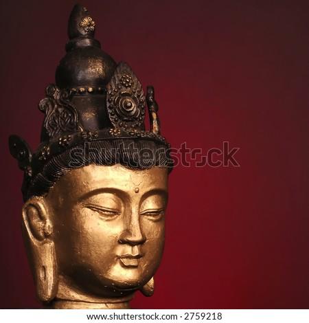 Serene Buddha head on red background - stock photo