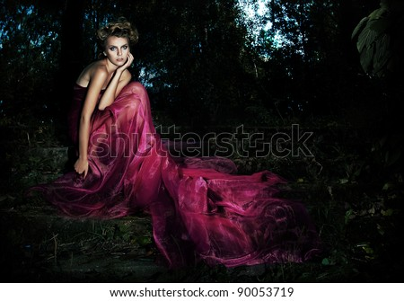 Serene. Evening Scenic - Seductive fairy girl in Long Dress sitting on Stairs in the Forest - series of photos - stock photo