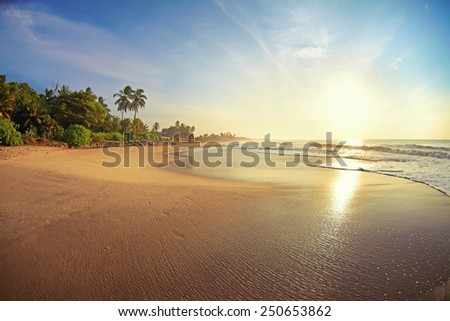 Serene sunrise on a tropical island paradise - stock photo