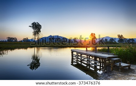 Serene Sunrise over fishing Jetty , hong kong Nam Sang Wai - stock photo
