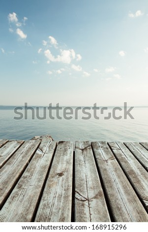 Serene view from pier to the lake - stock photo