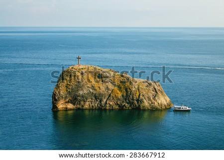 Serene view of Saint George rock island in Crimea - stock photo
